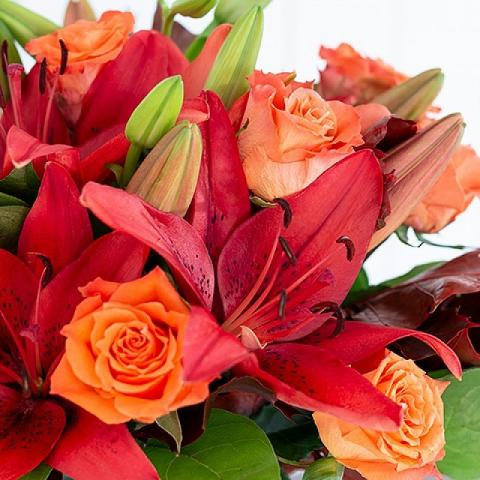 Autumnal Splendour: Lilies and Roses