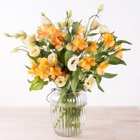 Gladioli arancioni in vaso di cristallo