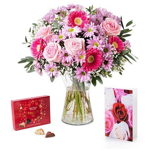 roses, chrysanthemums and germini with card and chocolates